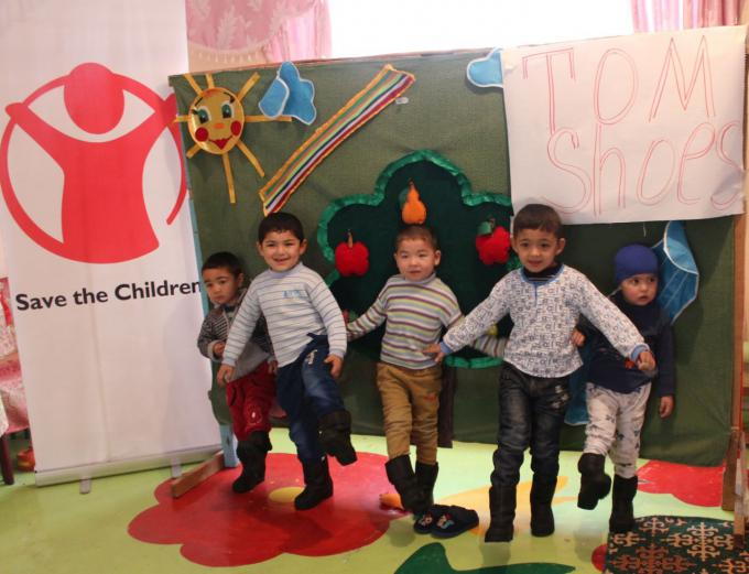 Children of Early Childhood Development Centre are demonstrating their new shoes, Kara-Su district of Osh province